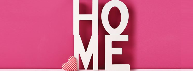 Home Sign on Pink Wall
